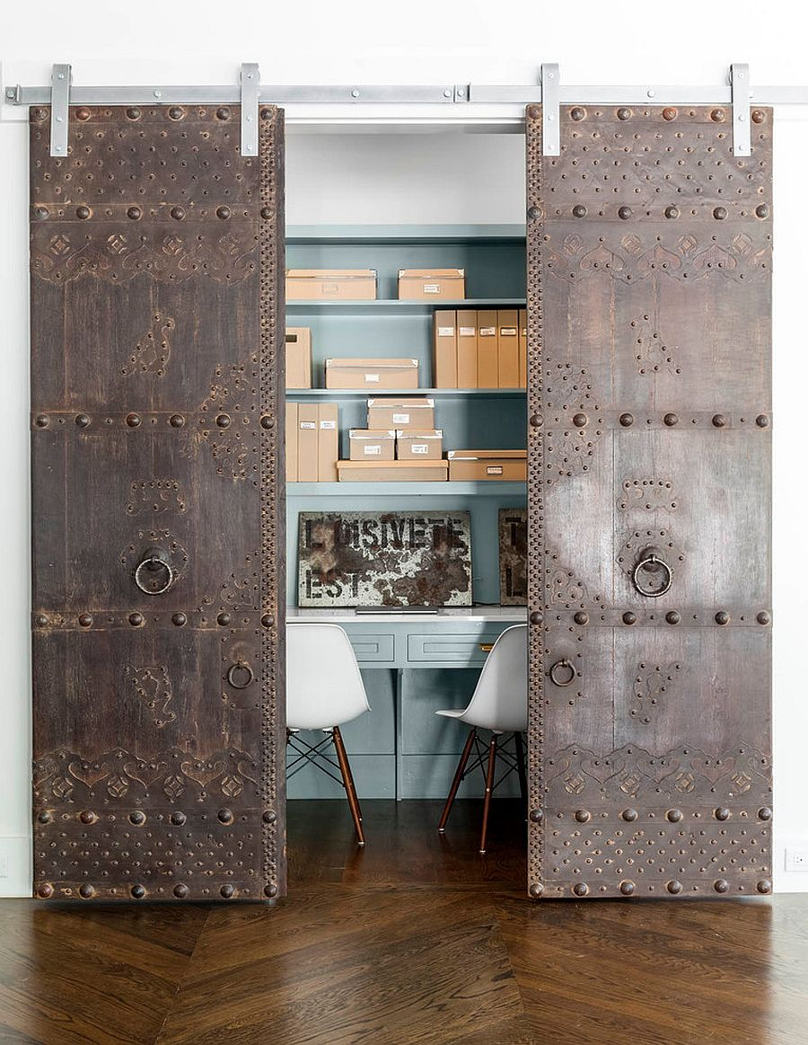 Rustic and antique sliding doors add uniqueness to the small home office [From: Robert Elliott Custom Homes / Nathan Schroder Photography]