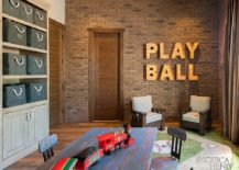 Rustic kids' playroom with bold design and brick wall