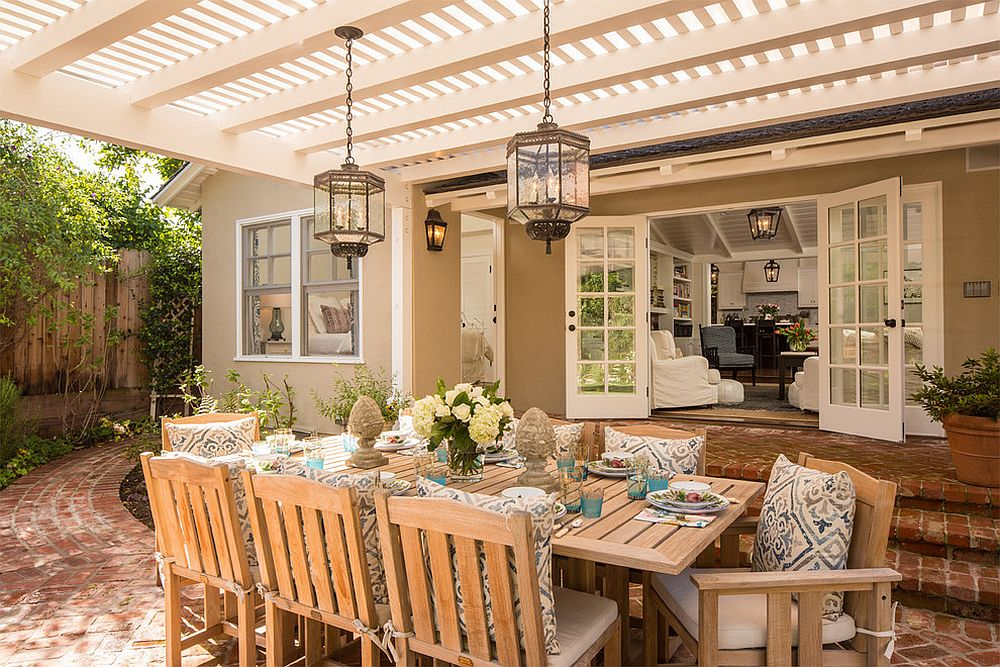 Rustic lanterns complete a beautiful and inviting outdoor dining space [Design: Abbott Moon]