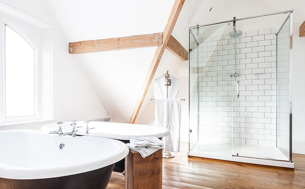 Scandinavian bathroom with standalone bathtub in black [Design: Attila Kemenyfi Photo & Film]