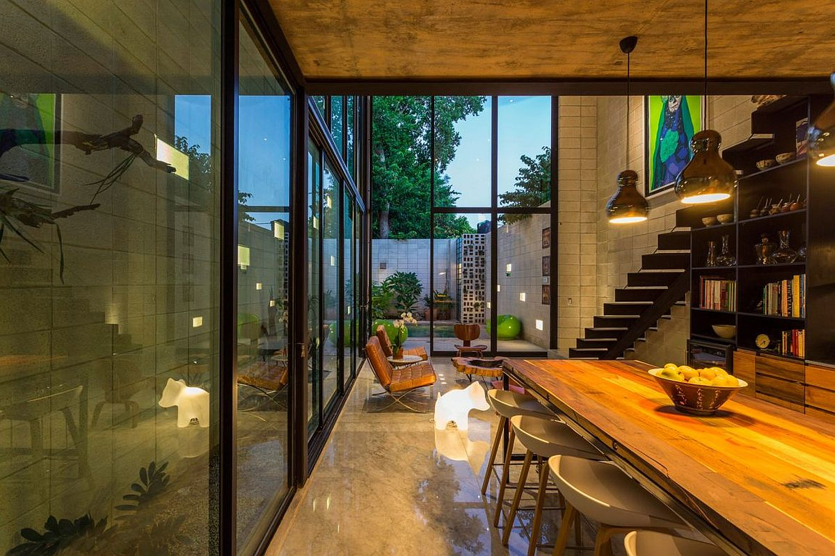 Series of glass walls up up the multi-level home to the world outside