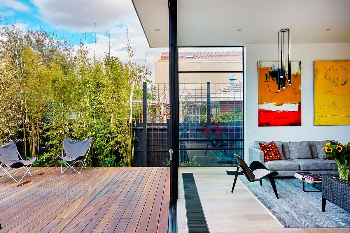 Sliding doors connect the new living area with the small deck outside