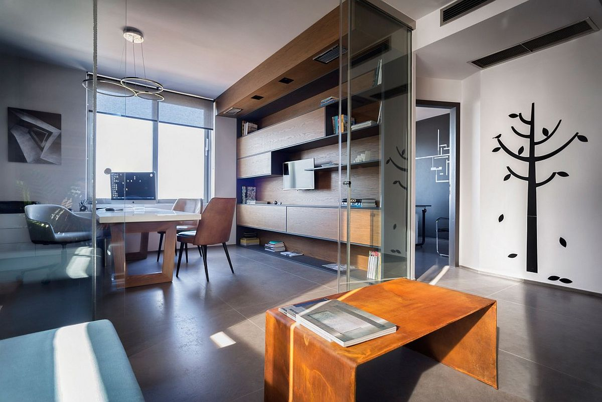 Sliding glass doors connect the office space with the lounge