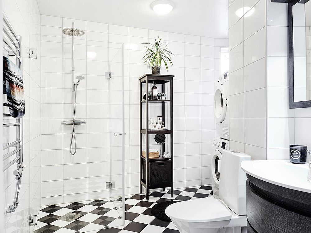 Small Scandinavian style bathroom in black and white [From: Entrance Fastighetsmäkleri]
