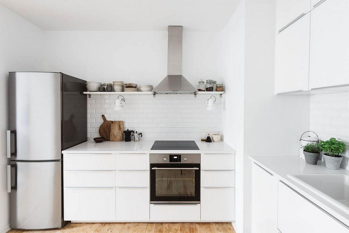 Small, all-white kitchen design with tiled backsplash