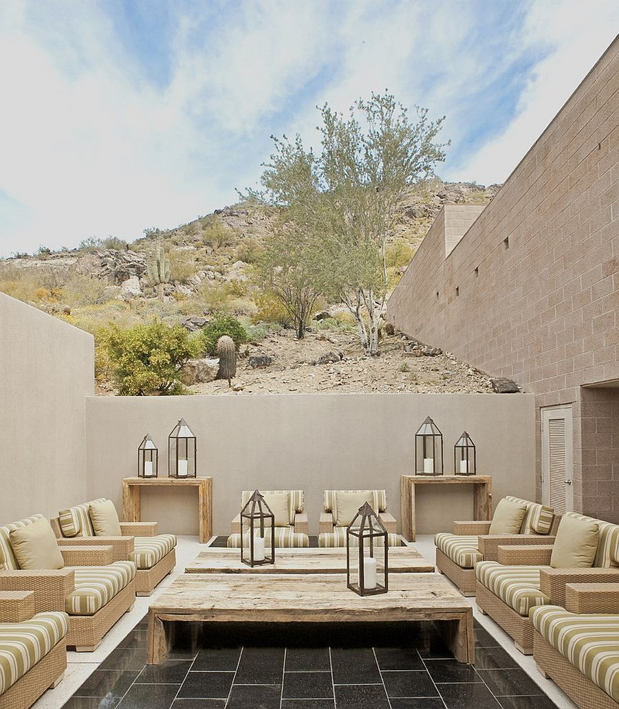 Small and private courtyard with breezy ambiance and wonderful lighting [Design: Palm Design Group]