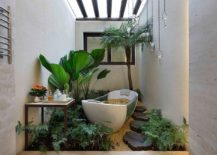 Small bathroom with plenty of greenery and a skylight