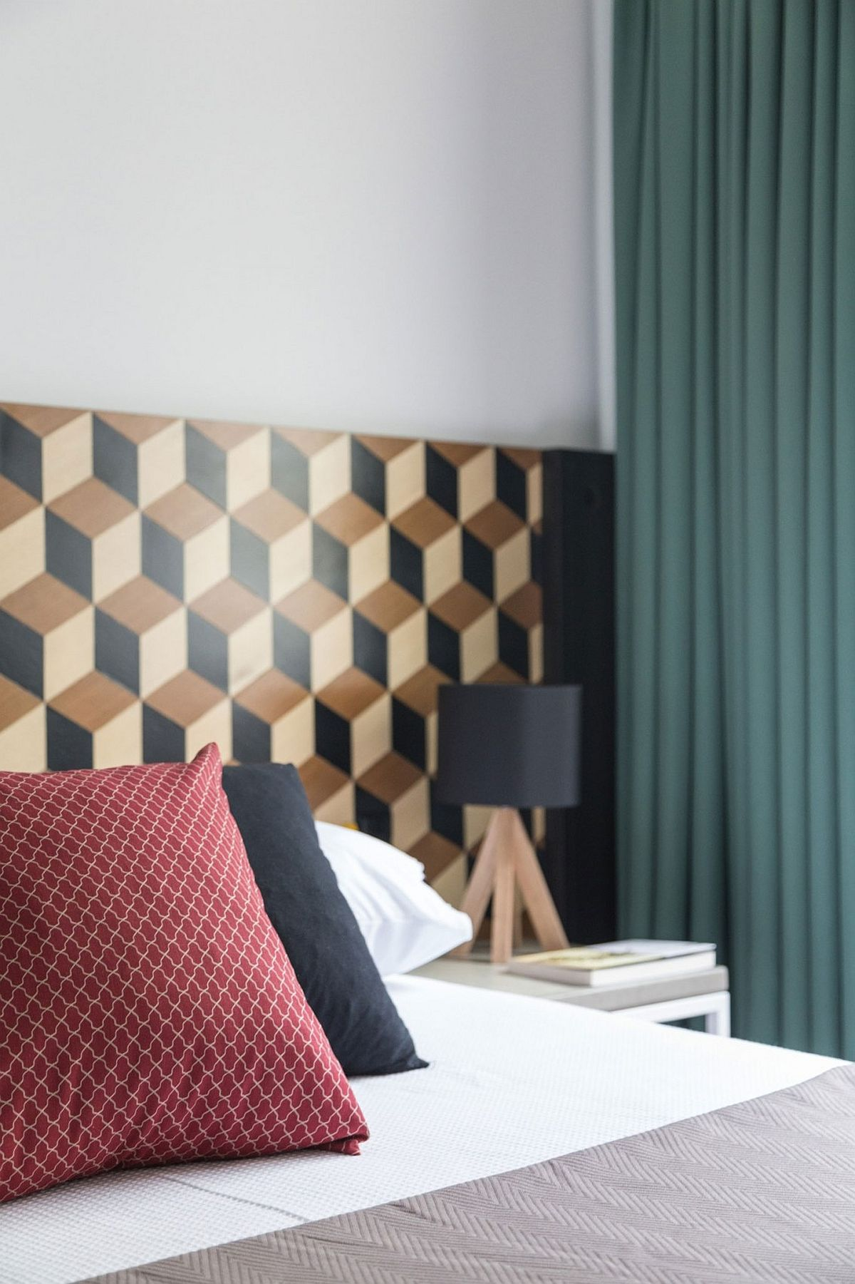 Small bedroom design with geometric wallpaper for the headboard wall