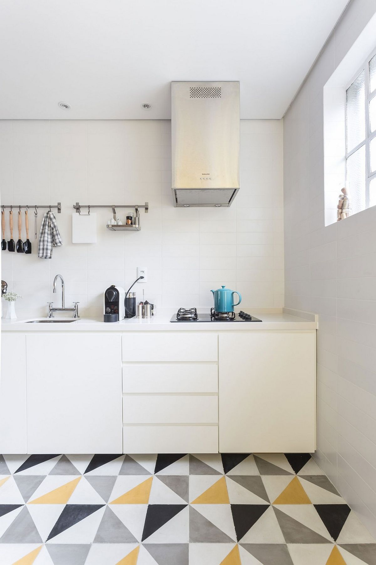 Small kitchen design in white with a counter that leads to the dining