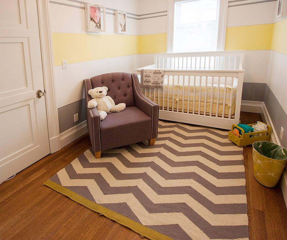 Small nursery with chevron pattern rug and striped wall [Design: Home & Stone/ Photography: Donald Grant]