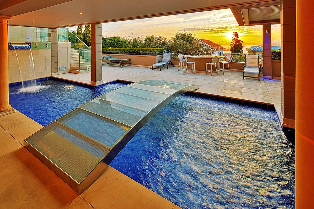 Smart and stylish bridge for the charming indoor pool [Design: Artesian Pools]