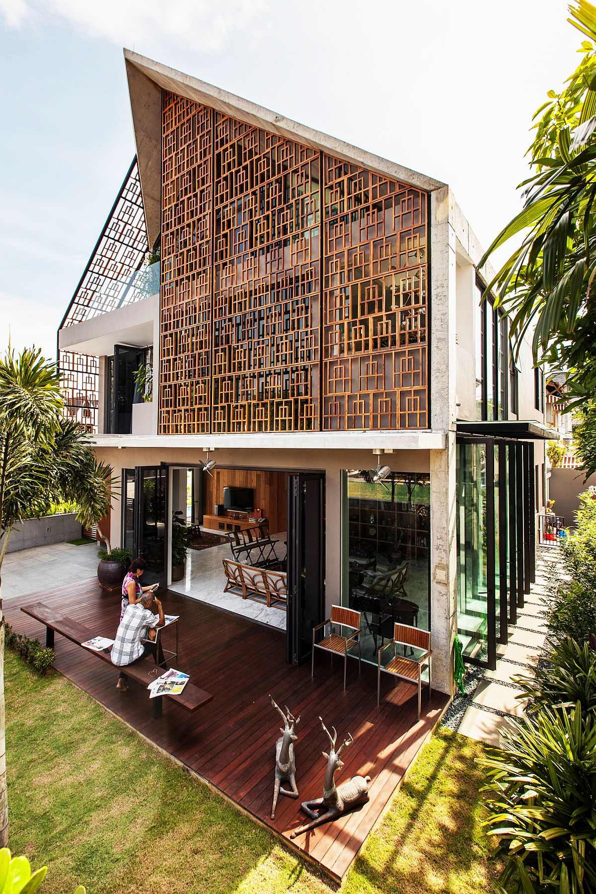 Smart modern home with lovely teak screens that filter in sunlight