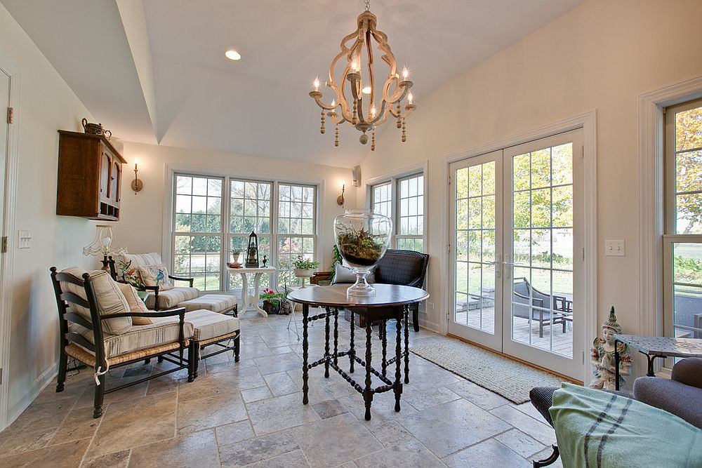 Spacious shabby chic style sunroom with ample storage and seating [Design: Interiors With A View]