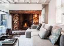Stacked wood and brick lining of the fireplace stand out visually