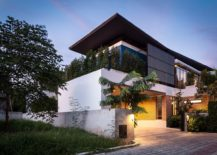 Street facade of Two Houses by Alkhemist Architects in Bangkok Thailand 217x155 Industrial and Modern Side by Side: Two Houses in Bangkok