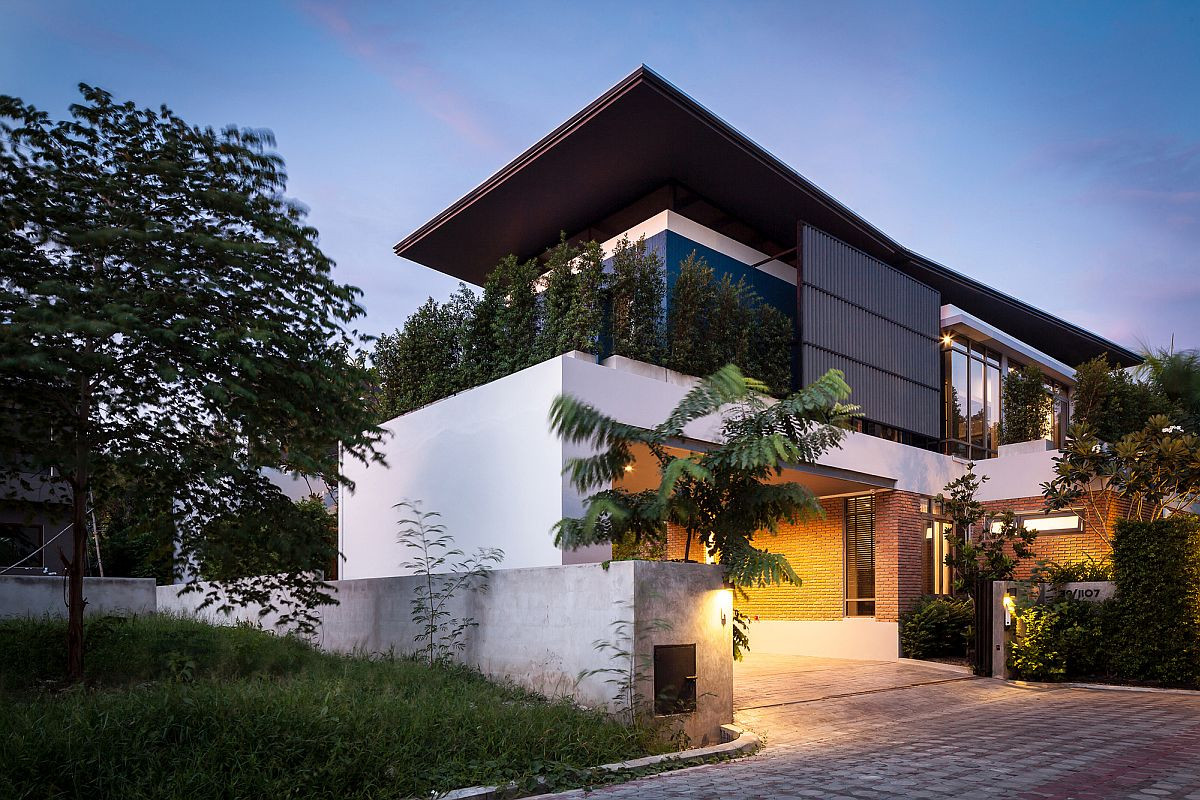 Street facade of Two Houses by Alkhemist Architects in Bangkok, Thailand
