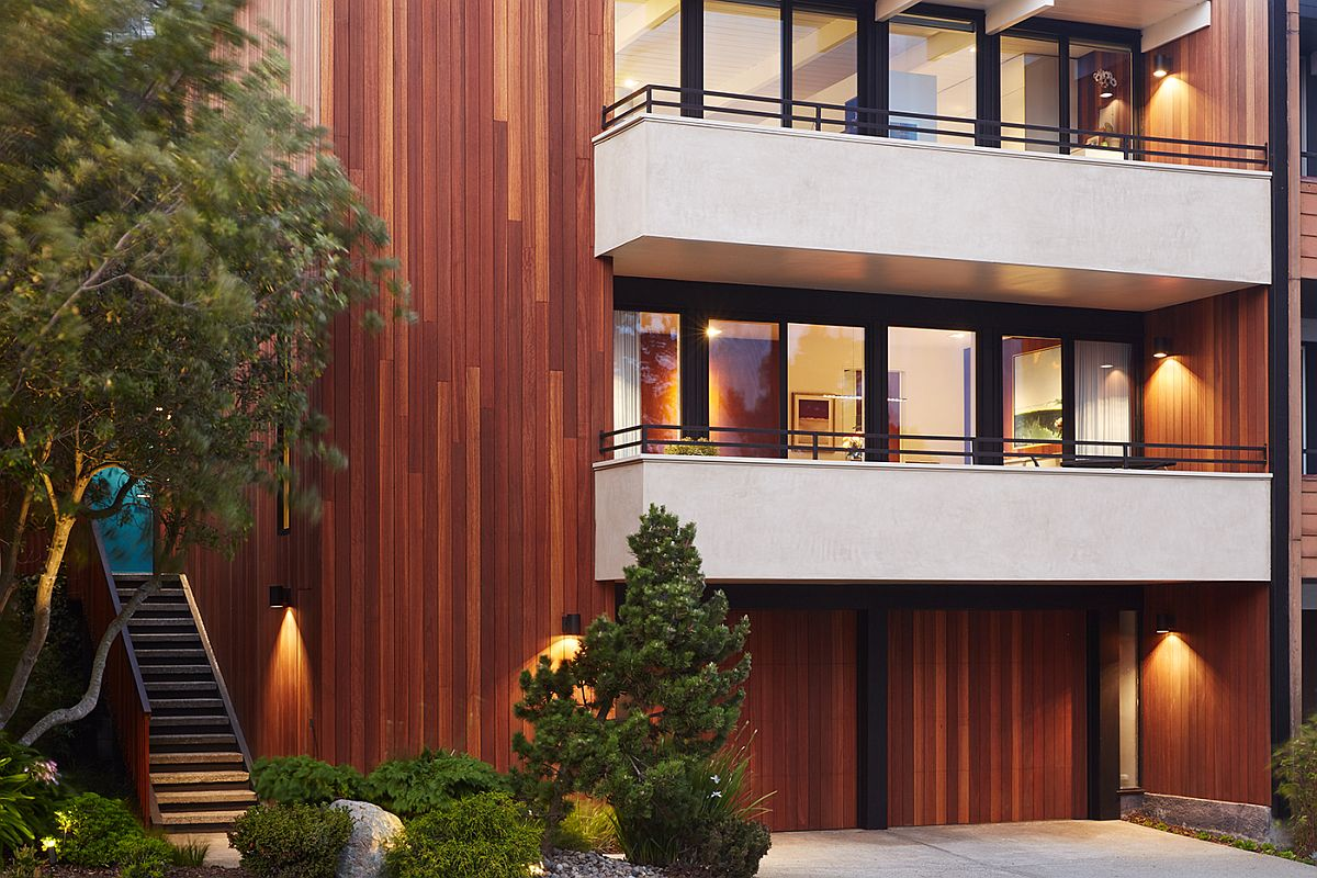 Street facade of the house combines inviting warmth with ample privacy