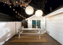 String lights coupled with two giant lanterns to illuminate the deck