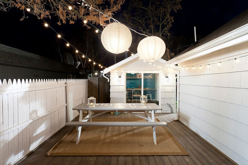 String lights coupled with two giant lanterns to illuminate the deck [Design: The Cousins]
