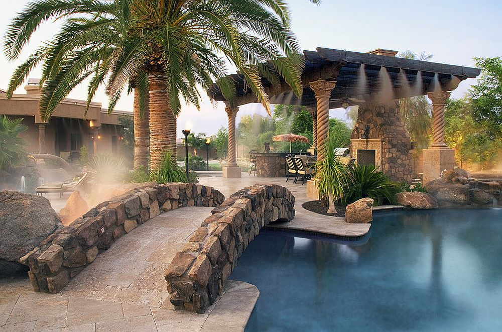 Stunning Mediterranean poolscape with stone siding that replicates natural stone [Design: Coronado Stone Products / Photography: Lee Ann White]