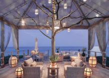 Stunning beach style deck with lovely lantern lighting that captivates