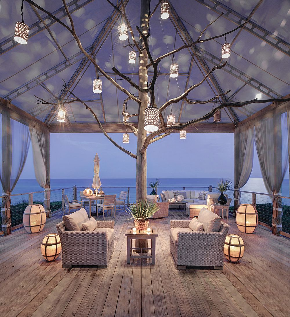 Stunning beach style deck with lovely lantern lighting that captivates [Design: Peters Billiards]