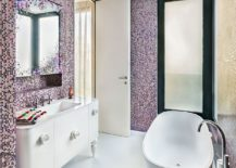 Stunning contemporary bathroom with standalone bathtub and tiles that usher in shades of violet