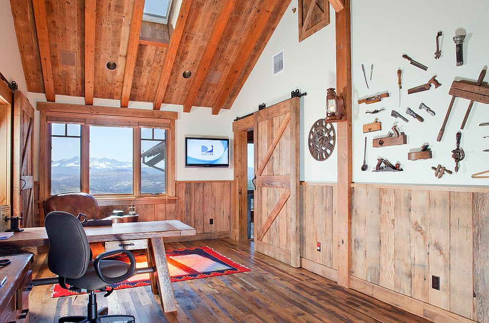 Stunning mountain views and rustic cabin style shape this lovely home office [Design: Centre Sky Architecture/ Photography: James Ray Spahn]