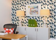 Table lamps accentuate the geometric beauty of the wallpaper