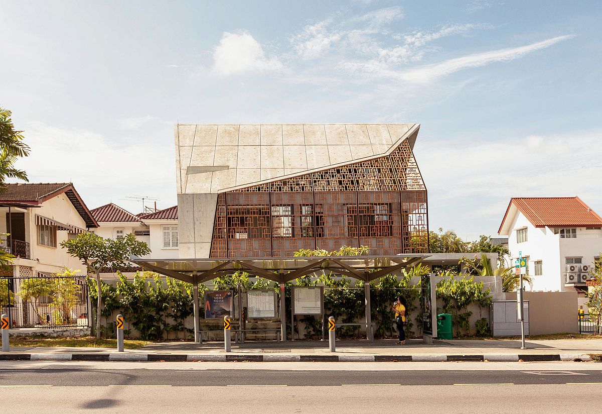 Teak screens from Bali give the contemporary home a distinct street facade