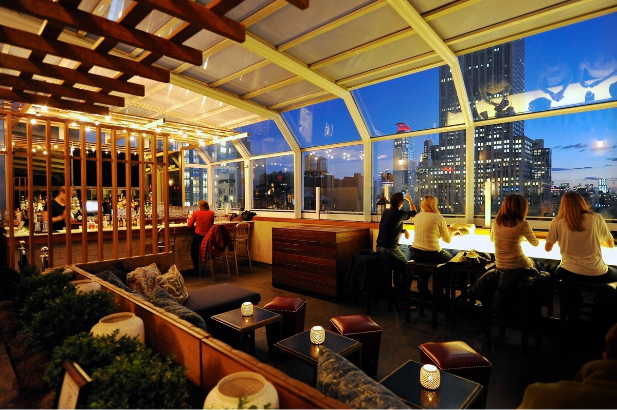 a toast to the high life 15 nyc rooftop bars. Black Bedroom Furniture Sets. Home Design Ideas