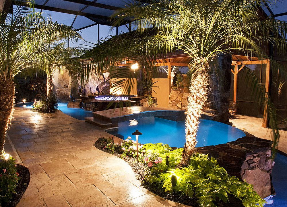 Tropical pool area and small garden around it brings ambiance of an exotic escape to your home [Design: Lucas Lagoons Inc.]