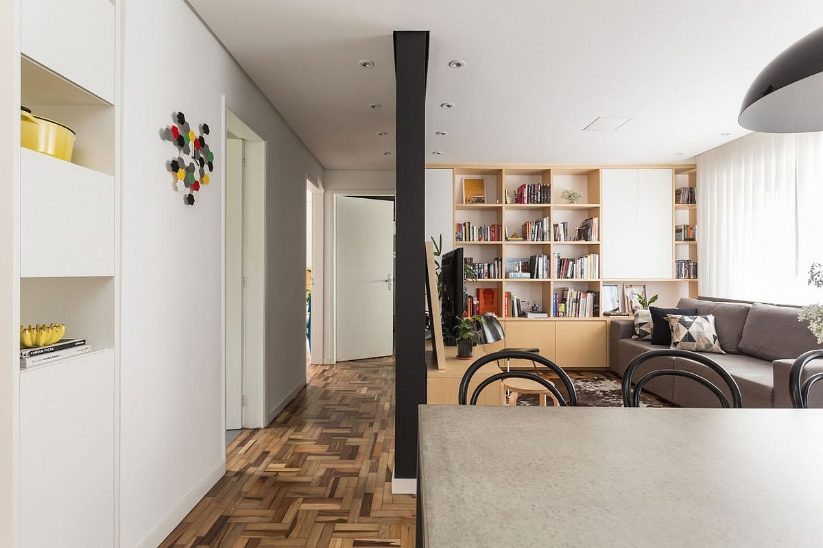 Unique herringbone pattern of the floor adds to the style of the small apartment