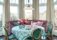 Vibrant turquoise and white tablecloth for a light-filled beach house
