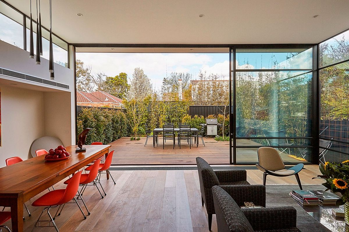 View of the modest backyard adds to the airy appeal of the living space
