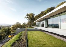View of the pool and the road leading to beautiful Villa K in lush green landscape 217x155 Pool That Seems to Float Above a Hill: Zero Energy, Minimalist Villa K