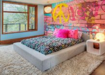 Wall mural brings the charm of brick wall covered in graffiti to the eclectic kids' space