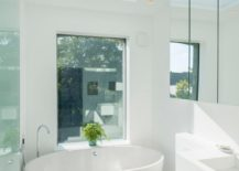 White bathroom with a plant in the window