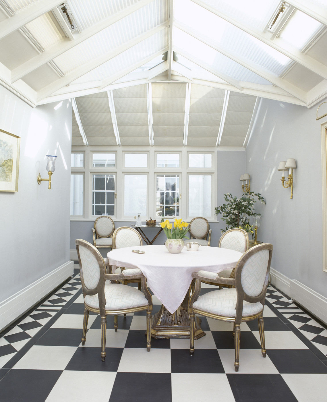 White round tablecloth in a checkered dining room