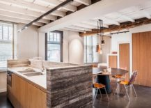 Wood, stainless steel and natural stone shape the fabulous kitchen