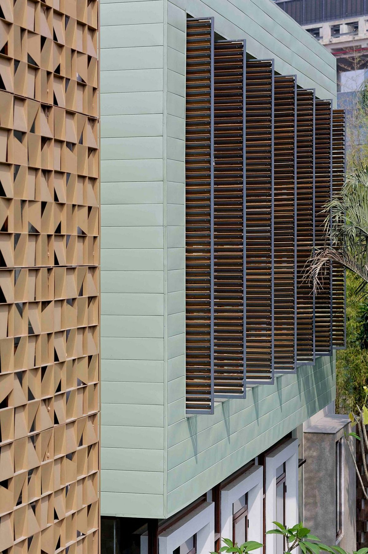 Wooden blinds allow the homeowners to switch between privacy and unabated views