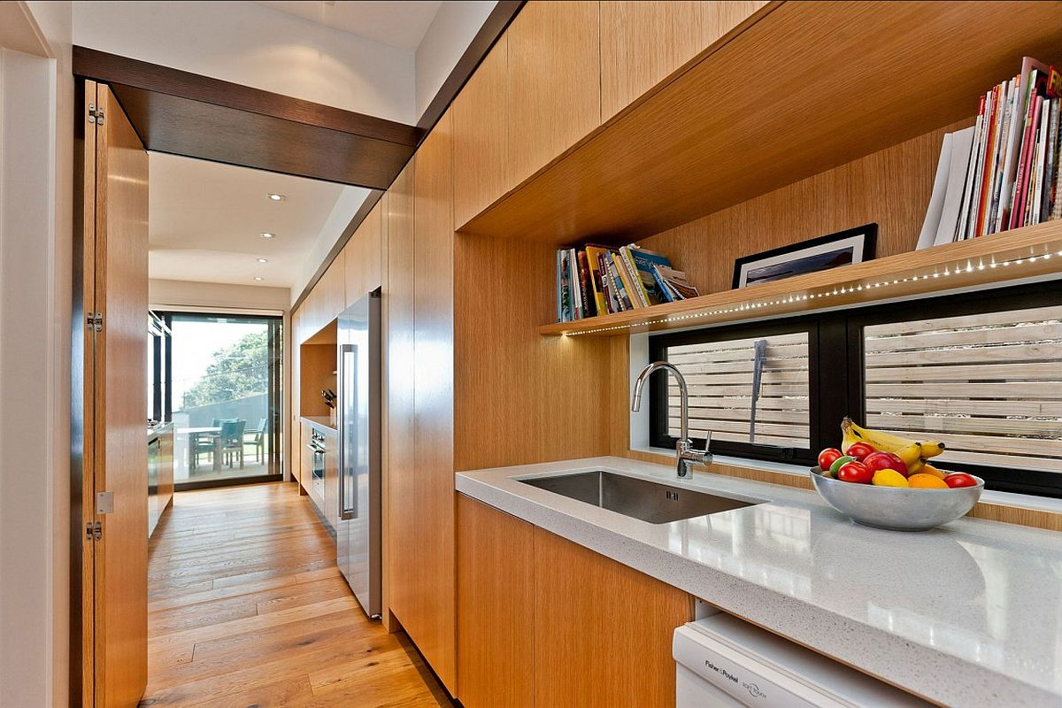 Wooden cabinetry adds warmth and classic elegance to the contemporary interior