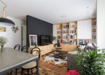 Wooden-cabinets-open-shelves-and-a-black-wall-fashion-a-fabulous-living-area-217x155
