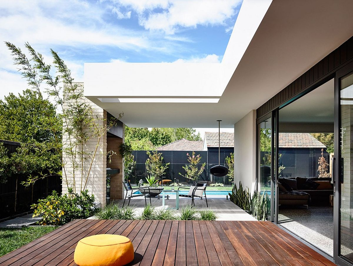 Wooden deck and loggia extend the living space outdoors