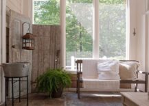 Wooden screen from salvaged doors inside the shabby chic sunroom
