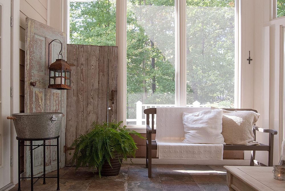 Wooden screen from salvaged doors inside the shabby chic sunroom [Design: Adrienne DeRosa]