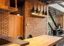 Wooden tables and industrial lighting for the kitchen and dining area