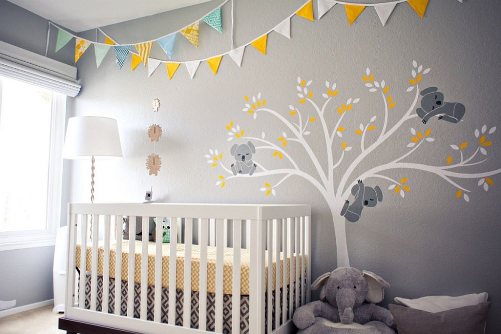 Yellow makes a big visual impact in this gray nursery despite its limited use