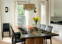 A glossy finish gives the dining table a more modern sheen