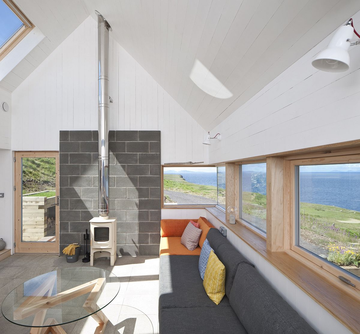 A series of timber framed windows connect the social zone with the outdoors